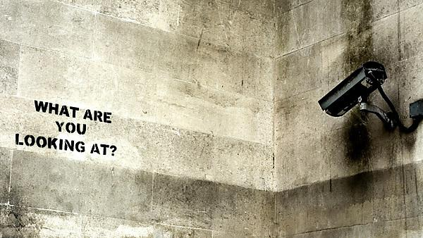 Surveillance camera and graffiti (image courtesy of iStock - 000011792920)