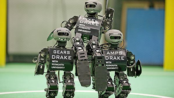 New robots about to make their debut for the Plymouth University Robot Football team. They are recreating the 1966 World Cup celebration with Bobby Moore on the shoulders of Geoff Hurst and Ray Wilson.
