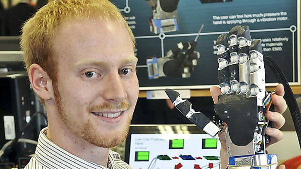 Joel Gibbard, with the robotic hand he made for his final year project