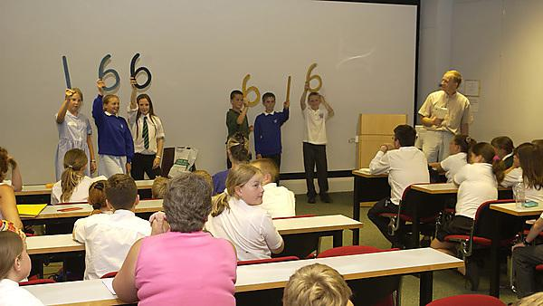 Local school pupils enjoy a mathematics workshop in the Plymouth University Scott Building.