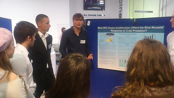 Students presenting research proposals