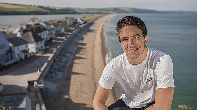 Postgraduate Open Evening 2015: man overlooking a beach and houses