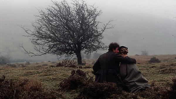 On the Black Hill film - man and lady sat beneath a tree