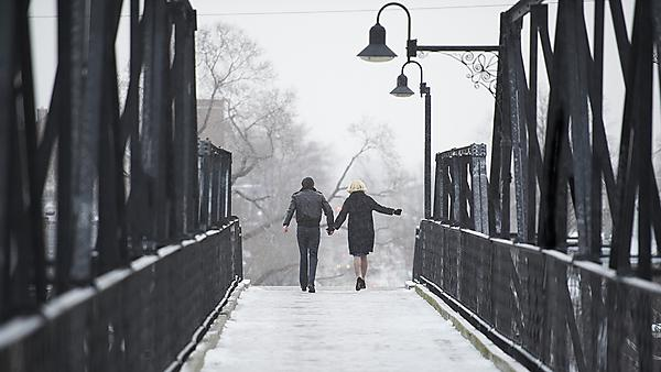 Stories we tell film - 2 people  walking over a bridge