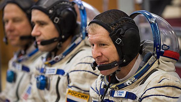 Tim with fellow crewmates Nasa astronaut Tim Kopra, and veteran Russian commander Yuri Malenchenko. He was blasted into space with them on 15 December 2015 to begin his six-month mission.