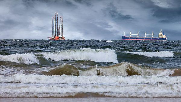 Oil Rig with ship at sea during a storm, Copyright: Nightman1965, courtesy of Shutterstock