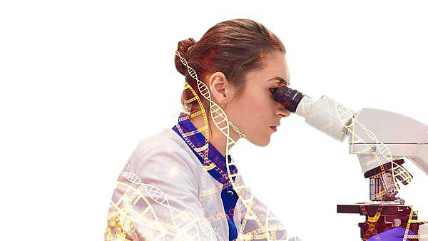 Derriford research facility Campaign image. Woman using a microscope.