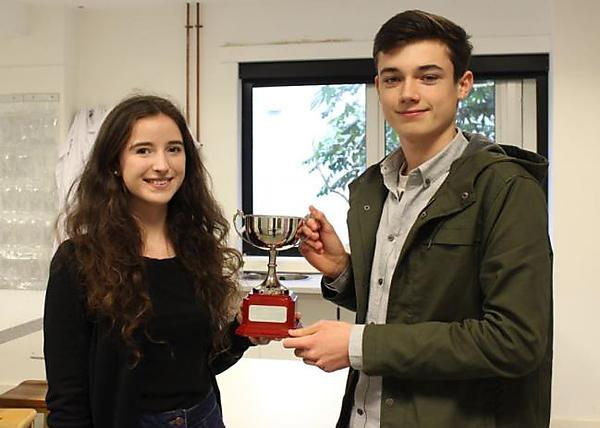 Two of the winners of the Western Region heat proudly display the trophy