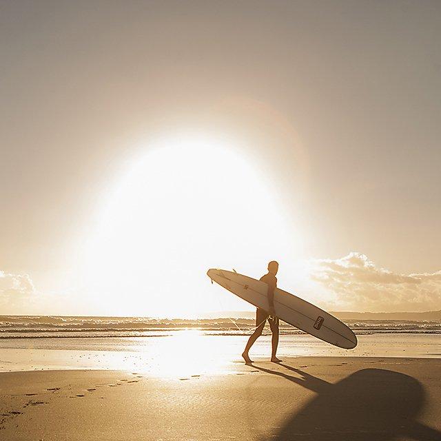 Surfer on Bigbury beach for the student life magazine