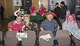 Supporters join in on Wear a Hat Day while watching Plymouth Raiders