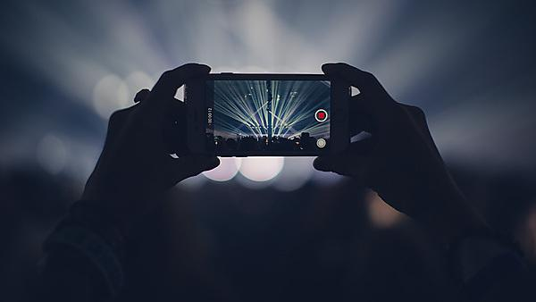 Filming a concert on a mobile phone