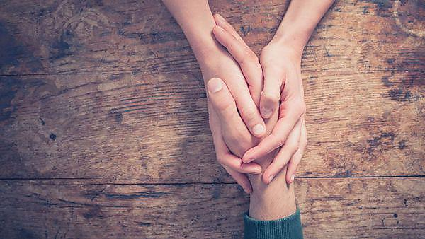 Holding hands - image courtesy of Shutterstock - 272600351