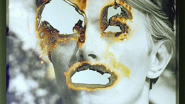 Douglas GordonSelf Portrait of You + Me (David Bowie), 2007. Burnt photographic print, smoke and mirror. © Studio lost but found / DACS 2016