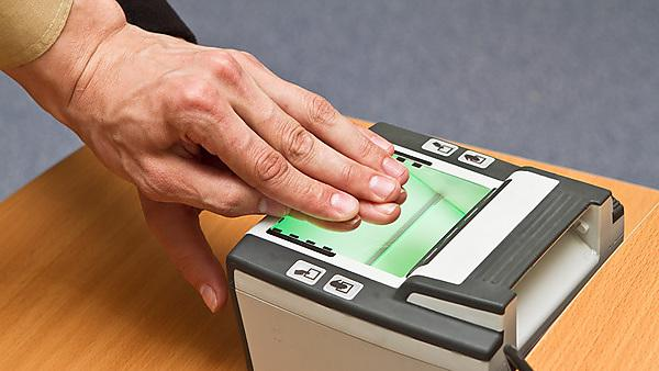 Scanning fingerprint. Image courtesy of Shutterstock