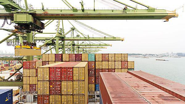 Harbour crane lifts container during cargo operation in port