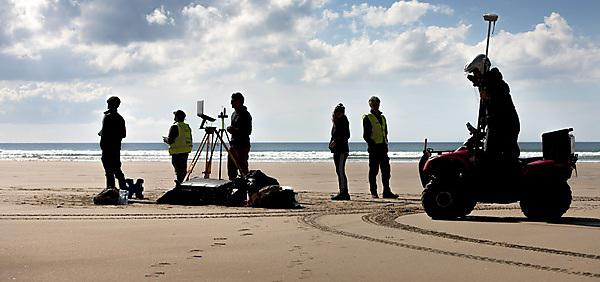 Members of Plymouth University's Coastal Processes Research Group conducting a full embayment survey at Perranporth, Cornwall. (Lloyd Russell, Plymouth University)