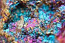 Bornite, also known as peacock ore, is a major source of copper and has been mined biologically using Bacteria and Archaea since the 1970s - these organisms thrive at pH 1 and at high temperatures found inside leaching heaps in South America.