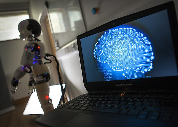 <p>Software Engineering Robot connected to a laptop mapping out its brain.</p>