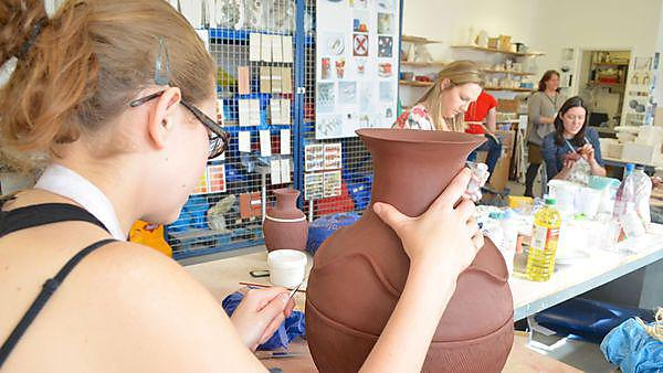 Students working in the ceramics studio