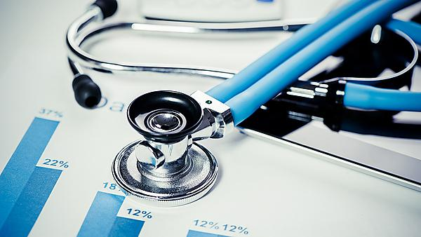 Stethoscope and medical statistics.