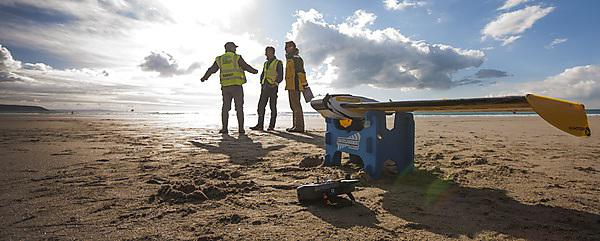 <p>Researchers from the University's Coastal Processes Research Group gathering data on <b></b>Perranporth beach</p>