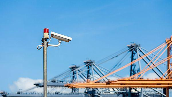 <p>Image of a security camera overlooking a sea port.</p>