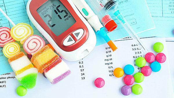 <p>Glucometer with unhealthy food,diabetes concept, Copyright: Umpaporn, courtesy of Shutterstock<br></p>