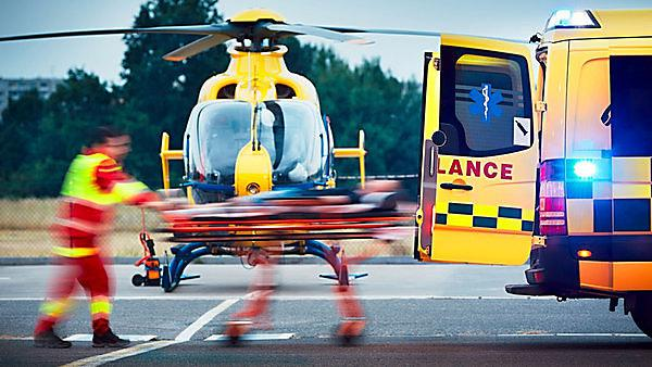 <p>Cooperation between air rescue service and emergency medical service on the ground. Paramedic is pulling stretcher with patient to the ambulance car.&nbsp;Copyright: Jaromir Chalabala, courtesy of Shutterstock<br></p>