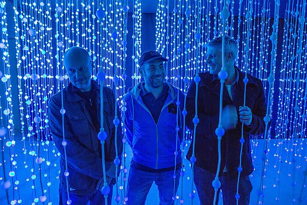 From left, Dr Anthony Rowe, Gareth Bushell and Professor Chris Bennewith with their work, Submergence. Credit: Paul Blakemore