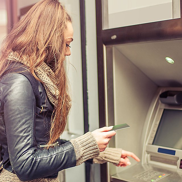 <p>Girl at a cash point</p>