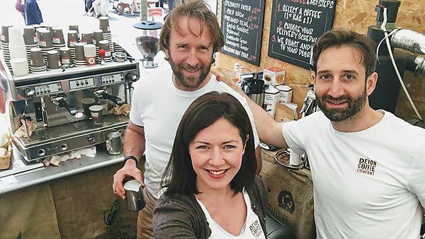 <p>Plymouth University student Yasmin Hajiyianni with employers at Devon Coffee Company.</p>
