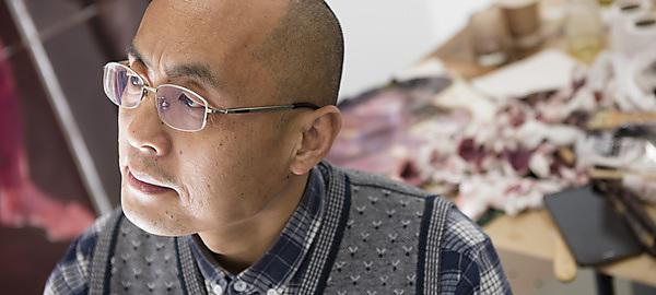 <p>Jiqun Zhang in his studios at Royal William Yard (Picture: Lloyd Russell)</p>