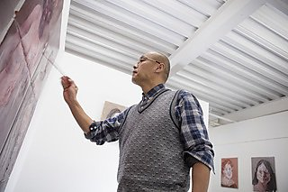 Jiqun Zhang at work in his studio
