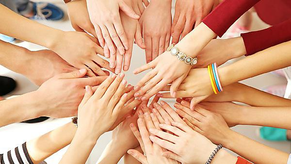 <p>Group of hands - Shutterstock image</p>