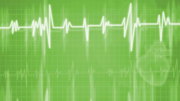 <p>Cardiogram. Heart on background. Image courtesy of Shutterstock.</p>