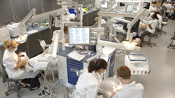 <p>Undergraduate dental students in Phantom Head room in Portland Square.