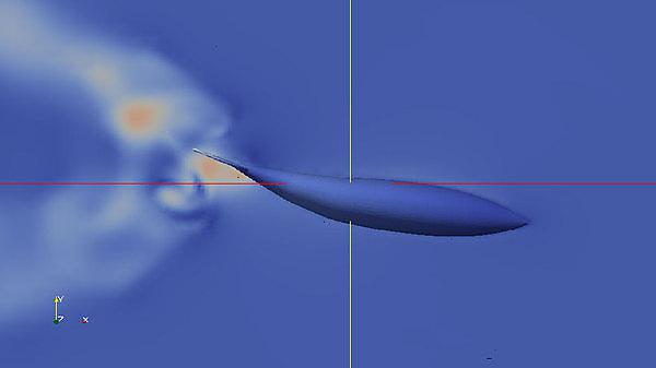 <p>Velocity contours around robot fish tail with optimised actuation</p>