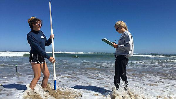 <p>Two female Oceanography students conducting fieldwork.</p>