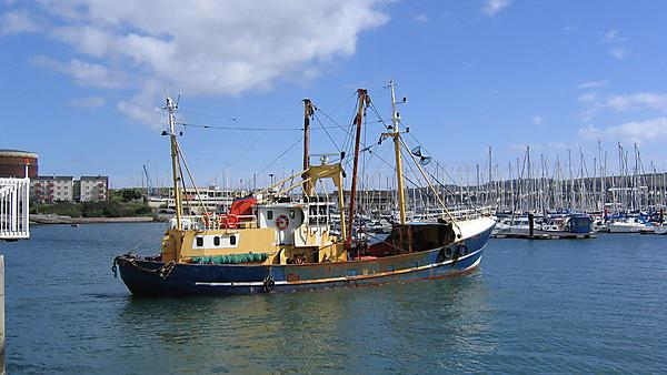 <p>Fishing trawler leaving Sutton Harbour - Getty Images</p>