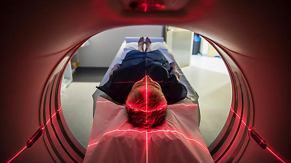 <p>Patient lying inside a medical scanner in hospital</p> Usage: Image courtesy GettyImages