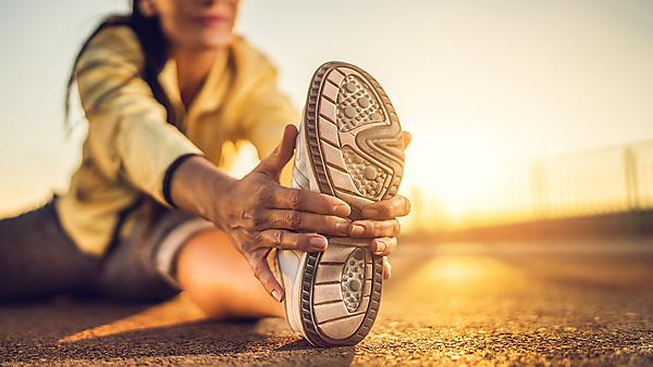 <p>  </p><div>Close-up of woman stretching her leg at sunset</div><p></p> Usage: Image courtesy GettyImages