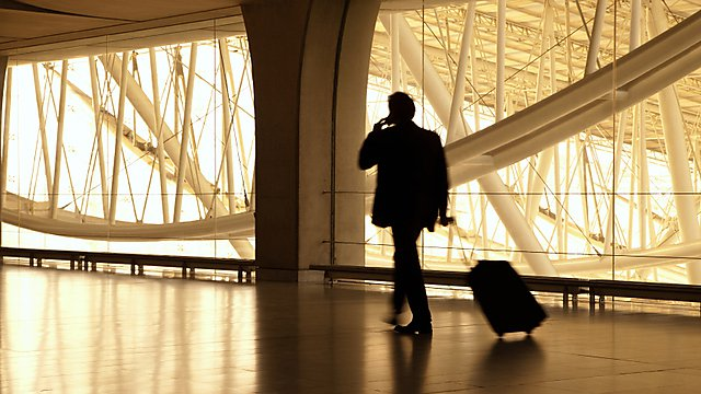 Businessman in airport courtesy of shutterstock