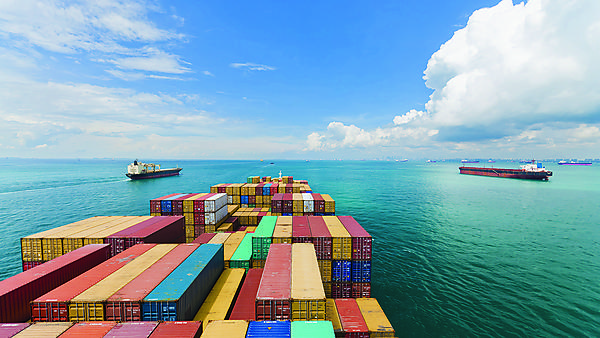 Care of Shutterstock - Cargo ships entering one of the busiest ports in the world, Singapore.