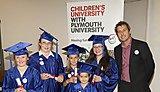 Children's University Chancellor, Professor Iain Stewart with Children's University graduates