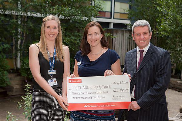 Sarah Bowman (left) and Professor Richard Stephenson (right) present the cheque to Bridget Woodard