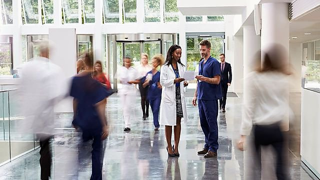 <p>Staff in busy lobby area of modern hospital, credit: monkeybusinessimages, courtesy of Getty Images</p>