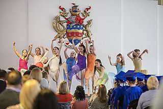 Performers at a ceremony in Rolle Marquee