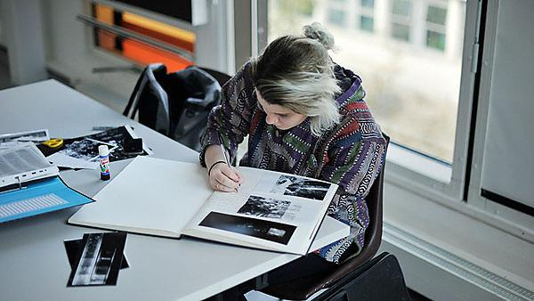 <p>Photography - girl studying at a desk</p>