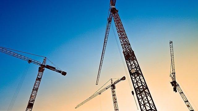 <p>  </p><div>four tower cranes on the blue sky</div><p></p>