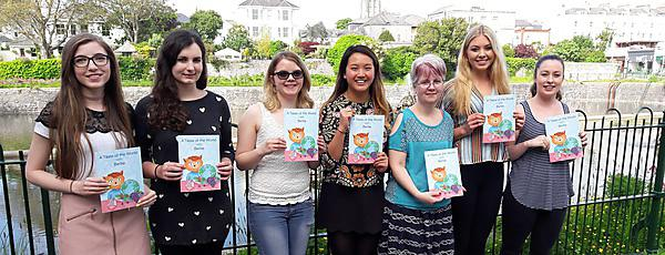 <p>(L-R) Danielle Tremeer, Hannah Stamp, Hannah Mackay, Alana Jiang-Weston, Lesley Clements, Rachel Hine and Becky Thomas with their book, <i>A Taste of the World with Bertie</i></p>